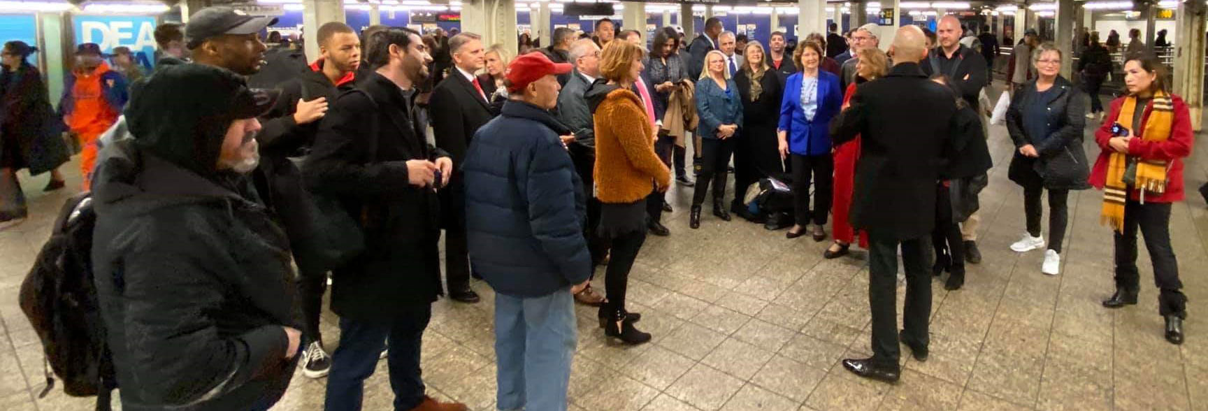 Leon Brie speaking in New York City subway station